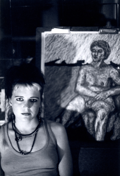Elizabeth Montague sitting in front of one of her life drawings in 1985.